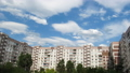 Clouds Moving Over The Multistorey Buildings. Time Lapse 49312839