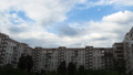 Clouds Moving Over The Multistorey Buildings. Time Lapse 49313180