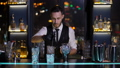 Barman stirring ice and alcohol in mixing glass 49385292