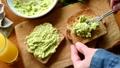 Man spread avocado on bread toast 49396705