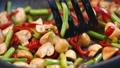 Stir Fry Cooking mushrooms and vegetables 49397425