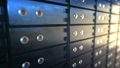 Close up of safe deposit boxes in a bank vault room, seamless loop 49412484