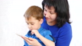 Happy family: Mom and son hold a smartphone and play with the application for children in the 49420709