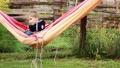 Cute funny happy joyful kid laying and relaxing in hammock. 1920x1080 49448392