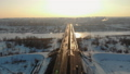 Road bridge over the river in winter against the evening city. FullHD 49488499