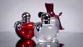 Modern glass perfume bottles rotate on white backg 49488769