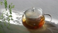 Asian Tam Swaying with Glass Teapot and Tea 49493082