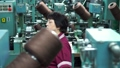 Female worker of a textile factory running on the machine, and installs and removes the spool of 49508112