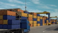 Blue lorry riding by containers 49517530