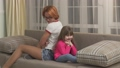 Mother and daughter spending time at home, having fun together. Little girl and her young mom 49517631