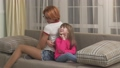 Mother and daughter spending time at home, having fun together. Little girl and her young mom 49517633