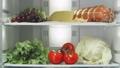 motion up along fridge shelves full of delicious food 49558726