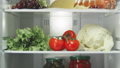 open domestic fridge with different products on shelves 49559292