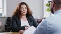 Plus size woman attending job interview 49593262