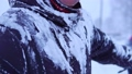 A man in snow-covered clothing. 49593937
