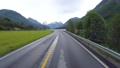 Driving a Car on a Road in Norway 49597939