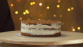 Chef removes a mold from a carrot cake with salted caramel 49600505