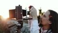Photographer customizes large format camera before shooting 49600577