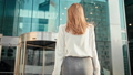 Business Woman in Shirt is Entering to Office Building via Glass Revolving Door 49611385