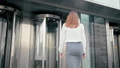 Business Woman is Entering into Office Building via Glass Revolving Door 49611389