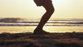 Silhouette of girl's legs jumping on the rope on the sea sand beach at sunset. 49631576