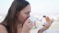 Portrait of woman having a breakfast in cafe on terrace. Side view. 49633873