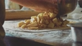 Woman Chef Baking Apple Strudel. Female Hands Spreading Apples onto Dough 49635478