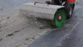 Man cleaning dirty snow on the road with read snow plow with brush 49639365