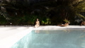 Beautiful swimming pool with bathing people, on a lost tropical island on a clear Sunny day 49641148