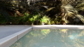 Beautiful swimming pool on a lost tropical island on a clear Sunny day. Realistic 3D animation. 49641149