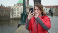 Girl staying at the bridge in European city 49644937
