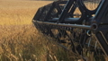 Combine harvester blades threshing wheat field 49649037