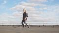 Male breakdancer dancing in urban surroundings 49679042