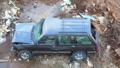 Broken machine left on a garbage dump. 49679138