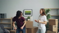 Young man and woman dancing smiling having fun at home celebrating relocation 49679139