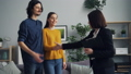 Man and woman buying house taking key shaking hands with realtor then kissing 49679155