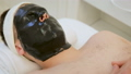 Care for men's skin in the spa. cosmetologist does face cleansing, cosmetic facial mask and skin 49682193