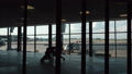 People walking in the terminal overlooking boarding plane. Moscow, Russia 49682900