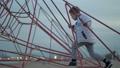 Active child on climbing net 49682925