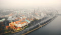 Amazing aerial cityscape panorama of Riga old town and car traffic along river Daugava under fog on 49686144