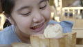 Happy little Asian girl enjoy eating ice cream 49695585