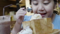 Happy little Asian girl enjoy eating ice cream 49695586