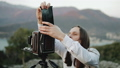 Photographer professional takes photos on a large format camera 49715837