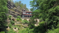 amazing old building in rocks in sunny day, unusual architecture in mountain 49722187