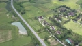 aerial view village near road surrounded by lush fields 49728476