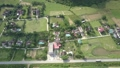 upper view nice village among green farm fields on sunny day 49728478