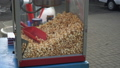 A lot of popcorn in a container at a city festival. Sweet caramel delicacy of corn is popular with 49730919