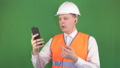 Young caucasian male boss talking on the phone video call in headphones at the construction site 49730927