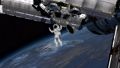 Astronaut Spacewalk, waving his hand in the open space. International Space Station ISS revolving 49732067