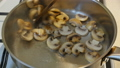 The cook fries champignon mushrooms are fried in a 49806008